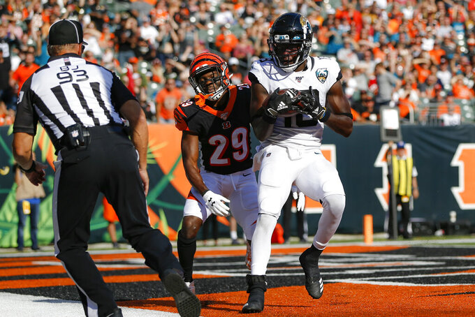 Jacksonville Jaguars wide receiver Chris Conley (18) scores a two-point conversation against Cincinnati Bengals cornerback Tony McRae (29) in the second half of an NFL football game, Sunday, Oct. 20, 2019, in Cincinnati. (AP Photo/Frank Victores)