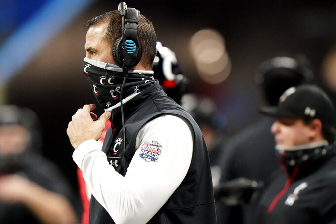 Cincinnati head coach Luke Fickell watches play against Georgia during the first half of the Peach Bowl NCAA college football game, Friday, Jan. 1, 2021, in Atlanta. (AP Photo/Brynn Anderson)