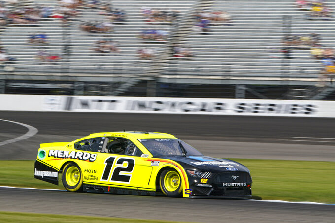 Ryan Blaney (12) drives through a turn during practice for the NASCAR Cup Series auto race at Indianapolis Motor Speedway in Indianapolis, Saturday, Aug. 14, 2021. (AP Photo/Michael Conroy)