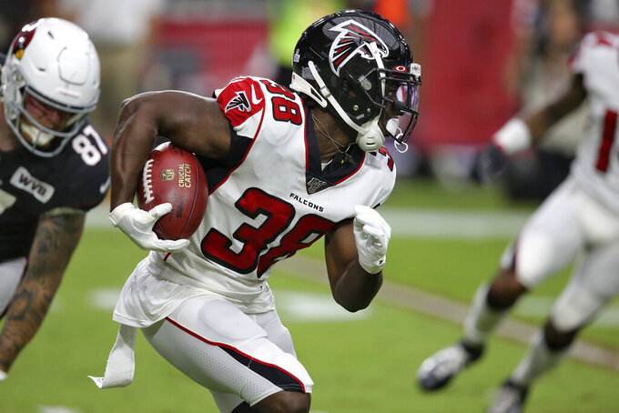 Atlanta Falcons running back Kenjon Barner (38) runs the ball against the Arizona Cardinals during the second half of an NFL football game, Sunday, Oct. 13, 2019, in Glendale, Ariz. (AP Photo/Ross D. Franklin)