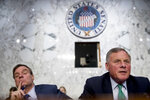 Senate Intelligence Chairman Richard Burr, R-N.C., right, accompanied by Committee Vice Chairman Mark Warner, D-Va., left, speaks during a Senate Intelligence Committee hearing on 'Policy Response to Russian Interference in the 2016 U.S. Elections' on Capitol Hill, Wednesday, June 20, 2018, in Washington. (AP Photo/Andrew Harnik)