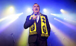Nashville Soccer Club CEO Ian Ayre speaks to fans at the unveiling of the MLS team's name, logo and colors Wednesday, Feb. 20, 2019, in Nashville, Tenn. The expansion franchise is due to start play in 2020. (AP Photo/Mark Humphrey)