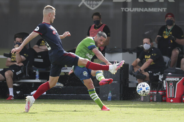 Seattle Sounders midfielder Nicolas Lodeiro, right, takes a shot on goal as Chicago Fire midfielder Fabian Herbers, left, tries to block the shot during the first half of an MLS soccer match, Tuesday, July 14, 2020, in Kissimmee, Fla. (AP Photo/John Raoux)
