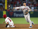 Houston Astros shortstop Alex Bregman, right, turns a double play next to Los Angeles Angels' Albert Pujols during the sixth inning of a baseball game in Anaheim, Calif., Thursday, July 18, 2019. Kole Calhoun was out at first. (AP Photo/Kyusung Gong)