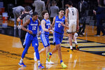 Kentucky's Keion Brooks Jr. (12), Devin Askew (2) and Jacob Toppin (0) leave the court after beating Vanderbilt in an NCAA college basketball game Wednesday, Feb. 17, 2021, in Nashville, Tenn. (AP Photo/Mark Humphrey)