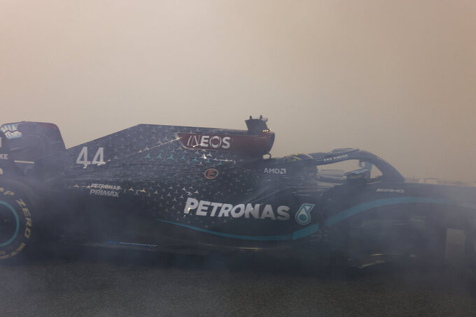 Mercedes driver Lewis Hamilton of Britain burns tires after the Formula One Abu Dhabi Grand Prix in Abu Dhabi, United Arab Emirates, Sunday, Dec. 13, 2020. (Giuseppe Cacace, Pool via AP)