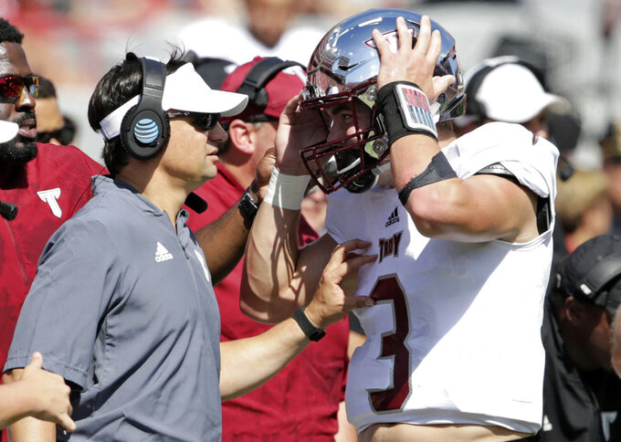FILE - In this Saturday, Sept. 15, 2018, file photo, Troy head coach Neal Brown talks to quarterback Sawyer Smith (3) during the first half of an NCAA college football game against Nebraska in Lincoln, Neb. After big wins in previous seasons, Troy haven't been able to maintain that momentum. Fresh from a 24-19 upset of Nebraska, the Trojans open Sun Belt play Saturday night at Louisiana-Monroe.  (AP Photo/Nati Harnik, File)