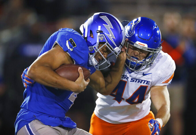 Boise State linebacker Riley Whimpey, right, sacks Air Force quarterback Isaiah Sanders in the second half of an NCAA college football game Saturday, Oct. 27, 2018, at Air Force Academy, Colo. (AP Photo/David Zalubowski)