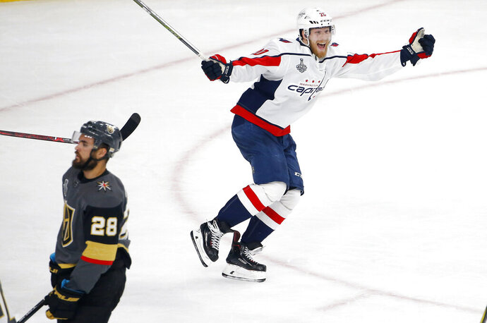 FILE - In this June 7, 2018, file photo, Washington Capitals center Lars Eller, right, celebrates his goal as Vegas Golden Knights left wing William Carrier skates away during the third period in Game 5 of the NHL hockey Stanley Cup Finals in Las Vegas. Paying the bills, going out to dinner and cutting the grass can fall by the wayside for NHL players on long playoff runs. With so much focus on hockey, everything on the outside is forgotten about this time of year. (AP Photo/Ross D. Franklin, File)