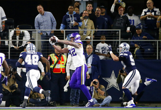 Minnesota Vikings tight end Kyle Rudolph (82) makes a catch for at touchdown between Dallas Cowboys' Joe Thomas (48) and Sean Lee (50) during the first half of an NFL football game in Arlington, Texas, Sunday, Nov. 10, 2019. (AP Photo/Ron Jenkins)