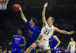 Presbyterian's JC Younger (25) keeps a rebound away from Notre Dame's Dane Goodwin (23) during an NCAA college basketball game Monday, Nov. 18, 2019, in South Bend, Ind. (Michael Caterina/South Bend Tribune via AP)