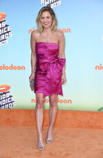 """This photo taken Saturday, March 23, 2019, shows Candace Cameron-Bure arriving at the Nickelodeon Kids' Choice Awards in Los Angeles. Bure says """"family sticks together no matter what,"""" in what seems a sign of support for """"Fuller House"""" co-star Lori Loughlin, who has been charged in an alleged college admissions scandal. Bure delivered that message in her acceptance speech Saturday night at the Nickelodeon Kids' Choice Award for Favorite Funny TV Show. She later shared those thoughts on Instagram. (Photo by Richard Shotwell/Invision/AP)"""