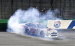 Cole Custer does a burnout following his victory in the NASCAR Xfinity Series auto race at Kentucky Speedway in Sparta, Ky., Friday, July 12, 2019. (AP Photo/Timothy D. Easley)