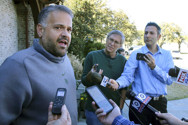 FILE - In this Jan. 7, 2020, file photo, former Baylor head football coach Matt Rhule speaks to reporters outside his home in Waco, Texas. In a normal year, new Carolina Panthers NFL football head coach Matt Rhule would have greeted many of the team's players for the first time with a handshake Monday for the start of the team's offseason workout program. But nothing is normal in the days of a global pandemic. (Jerry Larson/Waco Tribune-Herald via AP, File)