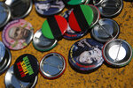 Buttons with Black Lives Matter, colors of the Pan-African flag, the image of George Floyd, left, and Breonna Taylor, right, are spread on the pavement on 16th Street Northwest at the area renamed Black Lives Matter Plaza north of the White House, Friday, June 19, 2020, in Washington. Juneteenth commemorates when the last enslaved African Americans learned they were free 155 years ago. Now, with support growing for the racial justice movement, 2020 may be remembered as the year the holiday reached a new level of recognition. (AP Photo/Carolyn Kaster)