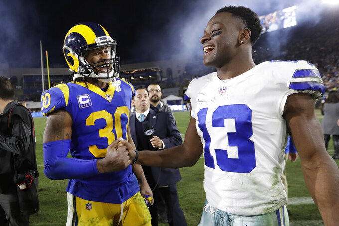 Los Angeles Rams running back Todd Gurley greets Dallas Cowboys wide receiver Michael Gallup after their win during an NFL divisional football playoff game Saturday, Jan. 12, 2019, in Los Angeles. (AP Photo/Marcio Jose Sanchez)