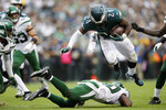 Philadelphia Eagles' Jordan Howard, right, is tackled by New York Jets' Marcus Maye during the second half of an NFL football game, Sunday, Oct. 6, 2019, in Philadelphia. (AP Photo/Matt Rourke)