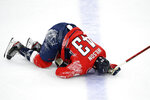 Washington Capitals right wing Tom Wilson lies on the ice after he was injured during the first period of the team's NHL hockey game against the Philadelphia Flyers, Saturday, May 8, 2021, in Washington. (AP Photo/Nick Wass)