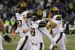 California kicker Greg Thomas, center, celebrates teammates after Thomas kicked the game-winning field goal late in the second half of an NCAA college football game against Washington in the early morning hours of Sunday, Sept. 8, 2019, in Seattle. California won 20-19. (AP Photo/Ted S. Warren)