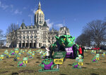 Opponents of highway tolls in Connecticut pose in front of an inflatable