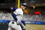 New York Yankees' Gleyber Torres celebrates as he runs the bases after hitting a home run during the second inning in Game 3 of a baseball American League Division Series against the Minnesota Twins, Monday, Oct. 7, 2019, in Minneapolis. (AP Photo/Bruce Kluckhohn)
