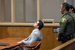 Defendant Hossein Nayeri sits in court following a guilty verdict in his trial, Friday, Aug. 16, 2019 in Newport Beach, Calif.  Nayeri, who previously escaped from jail and was on the run for a week was convicted Friday of kidnapping and torturing a marijuana dispensary owner who he mistakenly believed had buried large sums of money in the desert. (Paul Bersebach/The Orange County Register via AP)