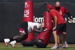 San Francisco 49ers' Javon Kinlaw, left, performs a drill in front of defensive line coach Kris Kocurek, foreground, during NFL football practice in Santa Clara, Calif., Saturday, Aug. 22, 2020. (AP Photo/Jeff Chiu, Pool)