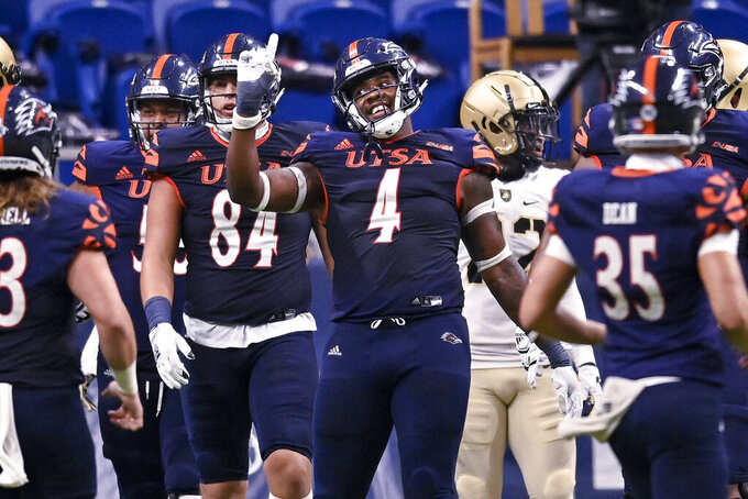 UTSA's Leroy Watson (4) celebrates a touchdown during the first half of an NCAA college football game against Army on Saturday, Oct. 17, 2020, in San Antonio, Texas. (AP Photo/Darren Abate)