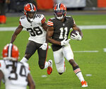 Cleveland Browns wide receiver Donovan Peoples-Jones runs after a catch next to cornerback A.J. Green during the NFL football team's scrimmage Friday, Sept. 4, 2020, in Cleveland. (Joshua Gunter/Cleveland.com via AP)