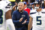 Seattle Seahawks head coach Pete Carroll speaks with players after a Seattle Seahawks field goal against the Atlanta Falcons during the first half of an NFL football game, Sunday, Oct. 27, 2019, in Atlanta. (AP Photo/John Bazemore)