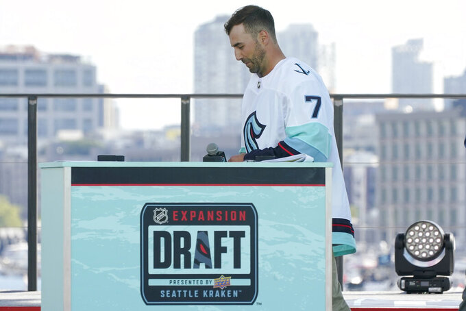 Jordan Eberle, a forward from the New York Islanders, walks off stage after being introduced as a new player for the Seattle Kraken, Wednesday, July 21, 2021, during the Kraken's NHL hockey expansion draft event in Seattle. (AP Photo/Ted S. Warren)