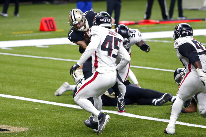 New Orleans Saints quarterback Taysom Hill (7) scores on a touchdown carry in the second half of an NFL football game against the Atlanta Falcons in New Orleans, Sunday, Nov. 22, 2020. (AP Photo/Brett Duke)
