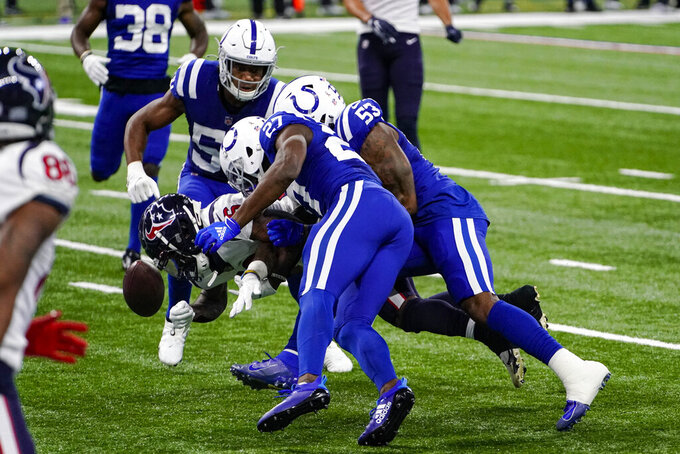 Houston Texans wide receiver Keke Coutee (16) fumbles the ball as he runs in the final minute of the second half against the Indianapolis Colts of an NFL football game in Indianapolis, Sunday, Dec. 20, 2020. (AP Photo/AJ Mast)