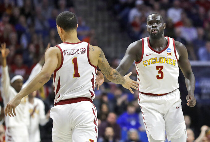 Iowa State's Marial Shayok (3) is congratulated by teammate Nick Weiler-Babb (1) after making a 3-point basket during the first half of a first round men's college basketball game against Ohio State in the NCAA Tournament Friday, March 22, 2019, in Tulsa, Okla. (AP Photo/Jeff Roberson)