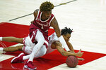 Utah guard Ian Martinez, bottom, and Stanford guard Daejon Davis (1) battle for the ball in the first half during an NCAA college basketball game Thursday, Jan. 14, 2021, in Salt Lake City. (AP Photo/Rick Bowmer)