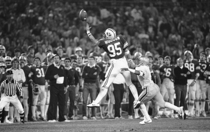 FILE - Brigham Young University tight end Gordon Hudson reaches up to make a one-handed catch for a 14-yard gain during the Holiday Bowl NCAA college football game against Ohio State in San Diego, in this Friday Dec. 17, 1982, file photo. Hudson, an All-American tight end for Brigham Young University and college football hall of famer, died Sept. 27, 2021. He was 59. He died in San Jose, California, the school said. (AP Photo/File)