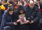 In this photo provided by the Ukrainian Presidential Press Office, relatives of one of the flight crew members of the Ukrainian 737-800 plane that crashed on the outskirts of Tehran, arrive for memorial service at Borispil International Airport outside Kyiv, Ukraine, Sunday, Jan. 19, 2020. A Ukrainian passenger jet carrying 176 people crashed just minutes after taking off from the Iranian capital's main airport on Jan. 8, 2020, killing all aboard.  (Ukrainian Presidential Press Office via AP)