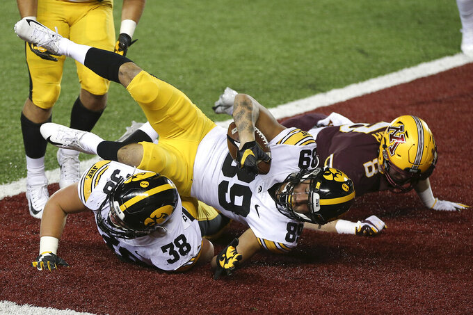 Iowa wide receiver Nico Ragaini (89) scores a touchdown against Minnesota during the first half NCAA college football game Friday, Nov. 13, 2020, in Minneapolis. (AP Photo/Stacy Bengs)
