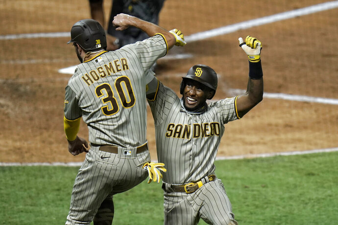 San Diego Padres' Jurickson Profar, right, celebrates his two-run home run with Eric Hosmer during the fourth inning of a baseball game against the Los Angeles Angels, Wednesday, Sept. 2, 2020, in Anaheim, Calif. (AP Photo/Jae C. Hong)