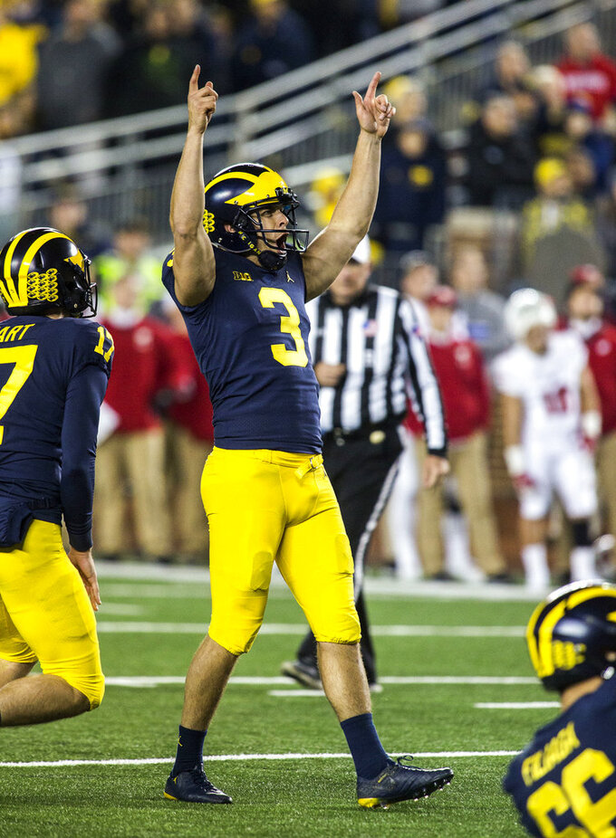 Michigan's Quinn Nordin (3) celebrates his 33-yard field goal in the second quarter of an NCAA college football game against Wisconsin in Ann Arbor, Mich., Saturday, Oct. 13, 2018. (AP Photo/Tony Ding)
