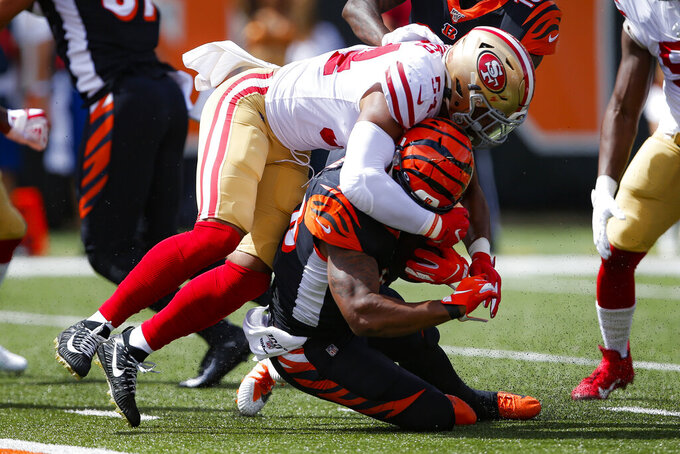 Cincinnati Bengals running back Joe Mixon, below, is tackled by San Francisco 49ers middle linebacker Fred Warner (54) during the first half an NFL football game, Sunday, Sept. 15, 2019, in Cincinnati. (AP Photo/Gary Landers)