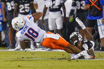 Boise State wide receiver Billy Bowens (18) is stopped by Central Florida defensive back Marco Domio after a reception during the first half of an NCAA college football game Thursday, Sept. 2, 2021, in Orlando, Fla. (AP Photo/John Raoux)