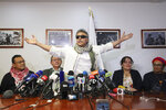 FILE - In this May 30, 2019 file photo, former rebel leader Seuxis Hernandez, also known as Jesus Santrich, opens his arms during a press conference at the FARC party headquarters after he was freed from his second detention in connection with a drug case in Bogota, Colombia. The rebel leader who abandoned a 2016 peace deal with Colombia's government and had been at large for three years was killed in Venezuela on Monday, May 18, 2021, according to a statement published by his new armed movement. (AP Photo/Fernando Vergara, File)