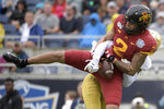Iowa State wide receiver Sean Shaw Jr. (2) catches a pass for a 28-yard gain in front of Notre Dame cornerback Troy Pride Jr. during the first half of the Camping World Bowl NCAA college football game Saturday, Dec. 28, 2019, in Orlando, Fla. (AP Photo/Phelan M. Ebenhack)