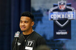 FILE - In this Feb. 25, 2020, file photo, Alabama quarterback Tua Tagovailoa speaks during a press conference at the NFL football scouting combine in Indianapolis. The rookie quarterback has reported to Miami Dolphins training camp and will practice without restrictions as he comes back from a knee injury and begins to compete to overtake veteran Ryan Fitzpatrick for the starting job. (AP Photo/Charlie Neibergall, File)