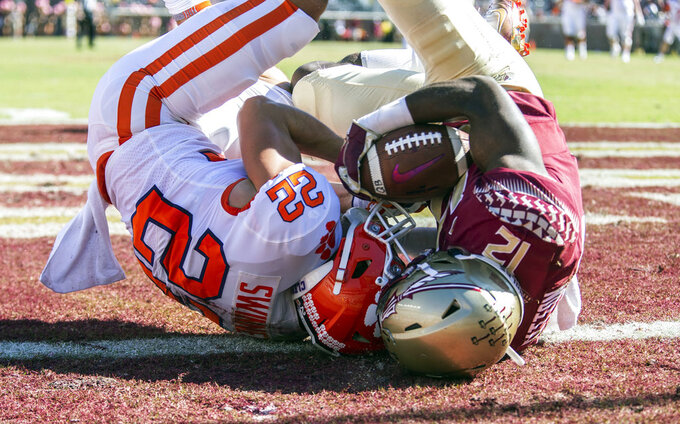 Florida State defensive back A.J. Lytton takes a Clemson pass away from Clemson wide receiver Will Swinney in the end zone for a touchback in the second half of an NCAA college football game in Tallahassee, Fla., Saturday, Oct. 27, 2018. Clemson defeated Florida State 59-10. (AP Photo/Mark Wallheiser)