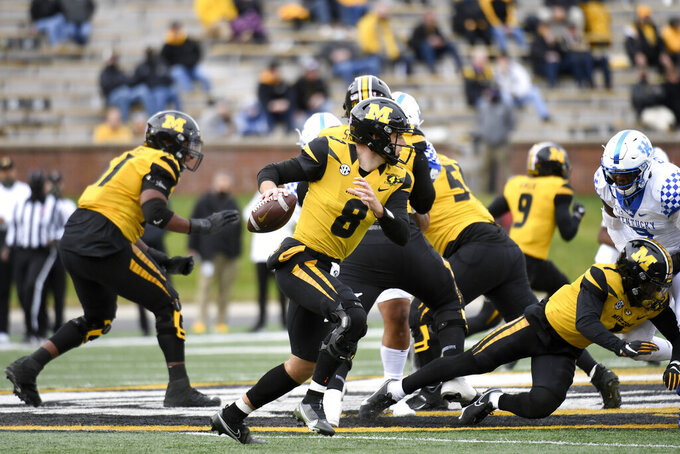 Missouri quarterback Connor Bazelak scrambles during the first half of an NCAA college football game against Kentucky Saturday, Oct. 24, 2020, in Columbia, Mo. (AP Photo/L.G. Patterson)