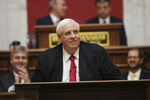 FILE - In this Jan. 8, 2020, file photo, West Virginia Governor Jim Justice delivers his annual State of the State address in the House Chambers at the state capitol in Charleston, W.Va. For a moment, West Virginia looked like it was going to be the only state in the country to allow betting on the presidential election. The short-lived play by bookmaker giant FanDuel was approved by the state lottery board. But it was announced and nixed within the span of about two hours Tuesday, April 7, 2020 in a bizarre sequence that appeared to baffle top government officials. Republican Gov. Jim Justice said it was ridiculous and he didn't know why the lottery commission would approve such a deal. (AP Photo/Chris Jackson, File)