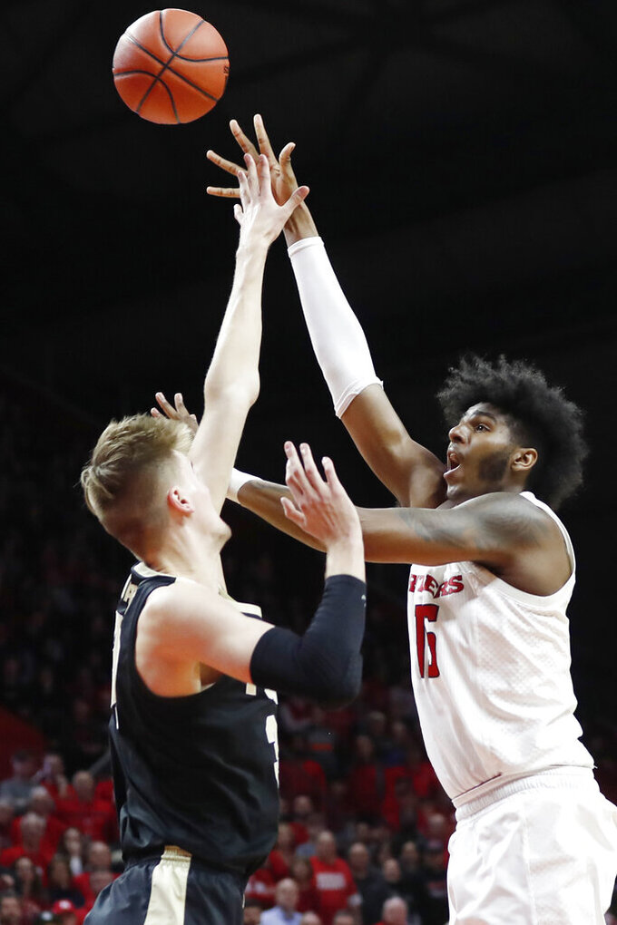 Rutgers center Myles Johnson, right, shoots over Purdue center Matt Haarms during the second half of an NCAA college basketball game Tuesday, Jan. 28, 2020, in Piscataway, N.J. (AP Photo/Kathy Willens)