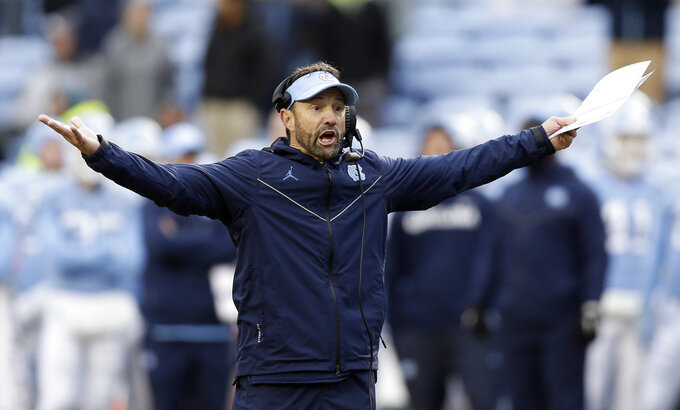 North Carolina head coach Larry Fedora reacts during the second half of an NCAA college football game against North Carolina State in Chapel Hill, N.C., Saturday, Nov. 24, 2018. North Carolina State won 34-28 in overtime. (AP Photo/Gerry Broome)